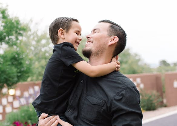 Man holding a smiling child